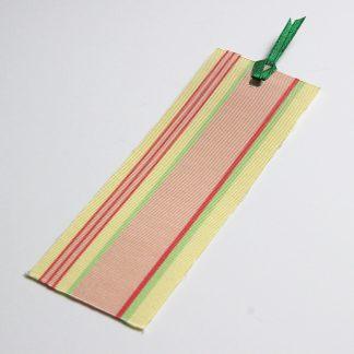 宮嶋美紀の博多織で作られたしおりです。うすい黄色地に赤色、桃色、黄緑色の縦線の模様です。