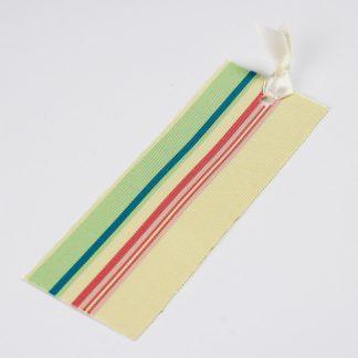 宮嶋美紀の博多織で作られたしおりです。うすい黄色地に黄緑、青、赤、桃色の縦線の模様です。