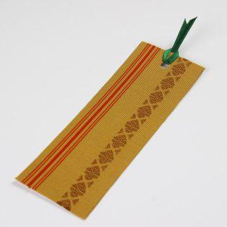 宮嶋美紀の博多織で作られたしおりです。黄色地に赤色の縦線と献上柄の模様です。